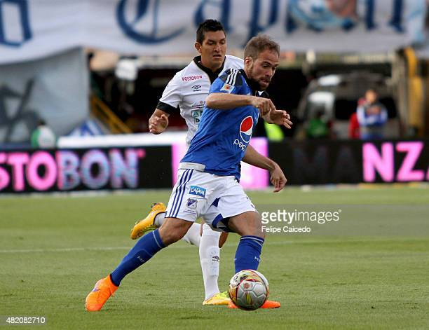 Federico Insua of Millonarios fights for the ball with Michael Ordoñez of Once Caldas during a match between Millonarios and Once Caldas as part of...