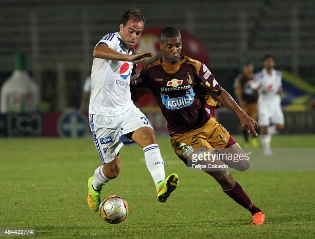 Federico Insua of Millonarios struggles for the ball with Danovis Banguero of Deportes Tolima during a match between Tolima and Millonarios as part...