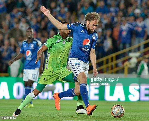 Federico Insua of Millonarios struggles for the ball with Elkin Barrera player of Jaguares FC during a match between Millonarios and Jaguares FC as...