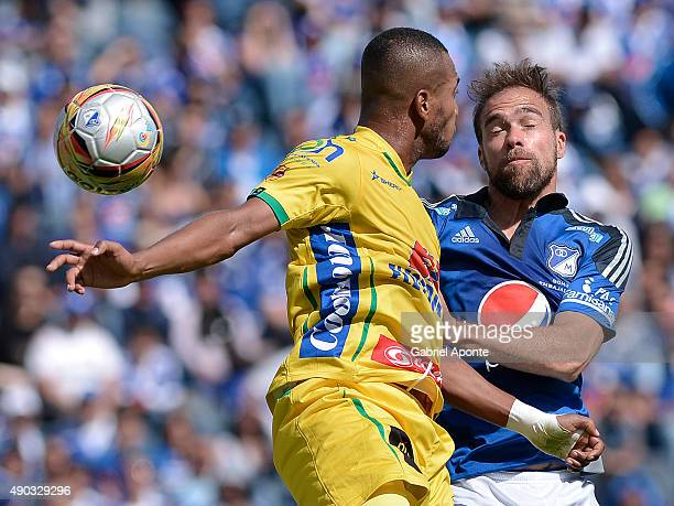 Federico Insua of Millonarios struggles for the ball with Felipe Alarcon player of Atletico Huila during a match between Millonarios and Ateltico...
