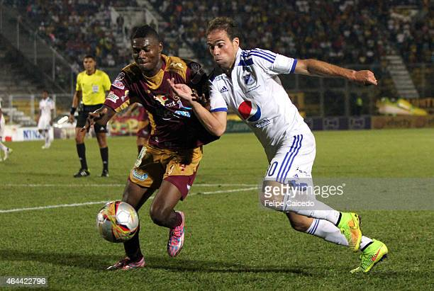 Federico Insua of Millonarios struggles for the ball with Henry Obando of Deportes Tolima during a match between Tolima and Millonarios as part of...