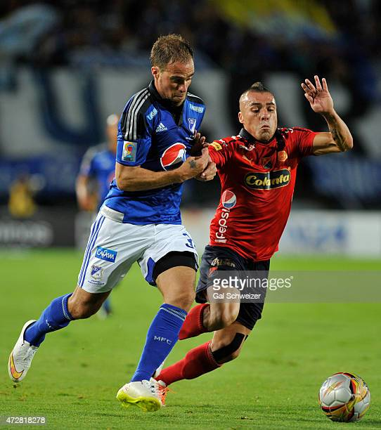 Federico Insua of Millonarios struggles for the ball with Vladimir Marin of Medellin during a match between Millonarios and Medellin as part of 19th...