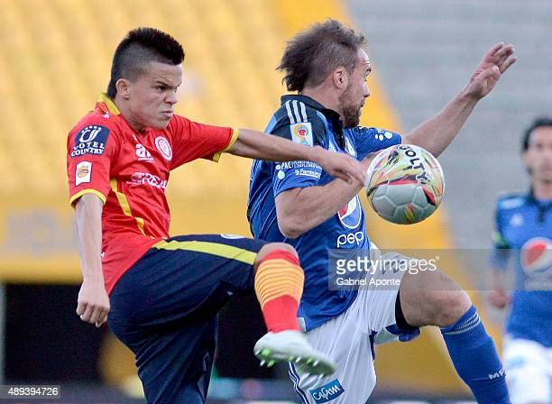 Federico Insua of Millonarios struggles for the ball with Walmer Pacheco of Uniautonoma during a match between Millonarios and Uniautonoma as part of...
