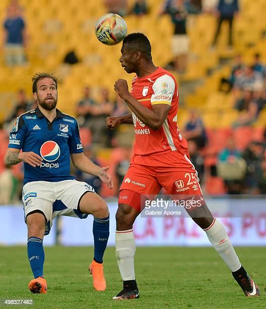 Federico Insua of Millonarios struggles for the ball with Yair Arrechea of Santa Fe during a match between Millonarios and Independiente Santa Fe as...