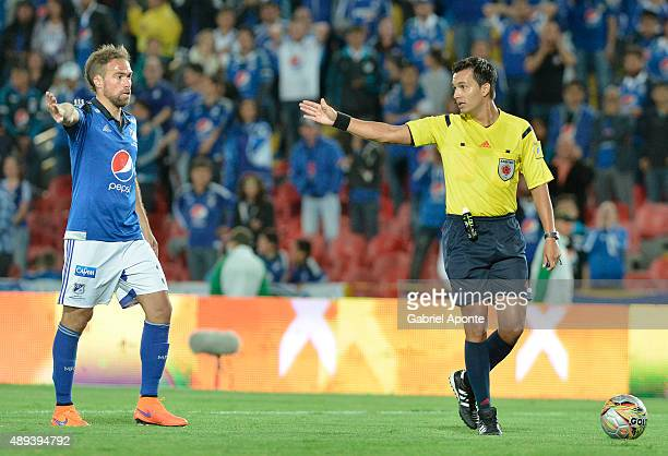 Federico Insua player of Millonarios argues with referee Nicolas Gallo about a goal disallowed during a match between Millonarios and Uniautonoma as...