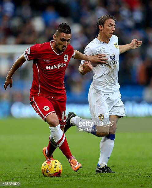 Federico Macheda of Cardiff holds off the challenge of Stephen Warnock of Leeds during the Sky Bet Championship match between Cardiff City and Leeds...