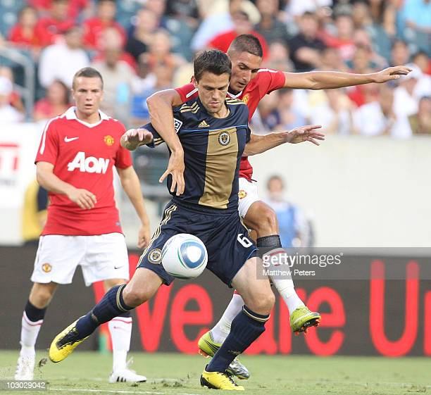 Federico Macheda of Manchester United clashes with Stefani Miglioranzi of Philadelphia Union during the pre-season friendly match between...