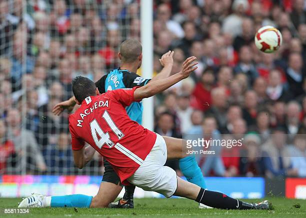 Federico Macheda of Manchester United scores their third goal during the Barclays Premier League match between Manchester United and Aston Villa at...