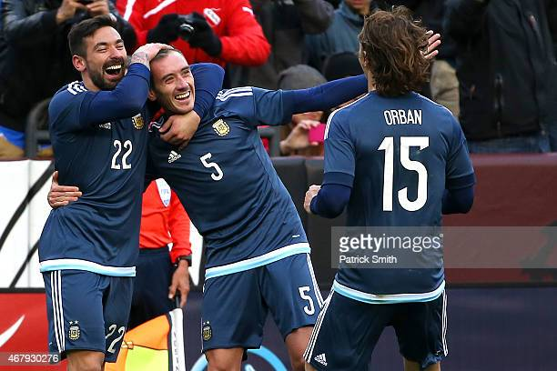 Federico Mancuello of Argentina celebrates his second half goal against El Salvador with teammates Ezequiel Lavezzi and Lucas Orban during an...