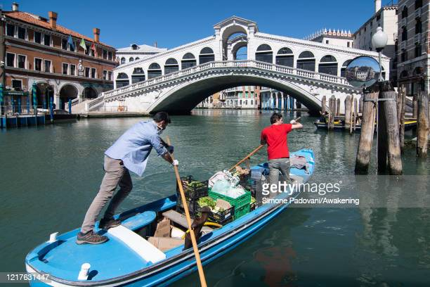 """Federico Mantova owner of """"Donna Gnora"""" farm, that delivers fruit and vegetables with rowing boats, and David Angeli sail the Grand Canal for the..."""