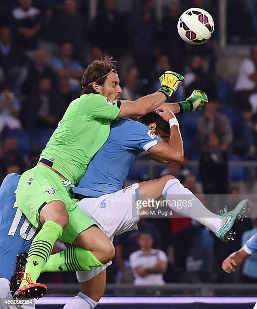 Federico Marchetti goalkeeper of Lazio and his team mate Lorik Cana jump for the ball during the Serie A match between SS Lazio and Udinese Calcio at...