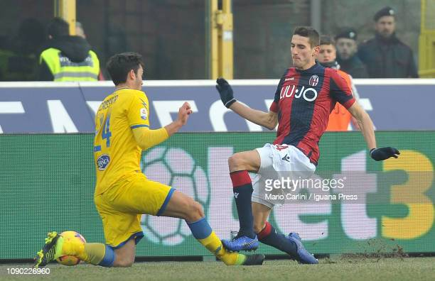 Federico Mattiello of Bologna FC fouls Francesco Cassata of Frosinone during the Serie A match between Bologna FC and Frosinone Calcio at Stadio...