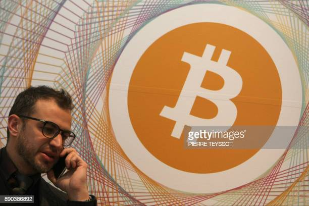 Federico Monti director of the startup 'bmanity' which manages the first Italian Bitcoin crypto currency shop 'Bitcoin Compro Euro' poses on December...