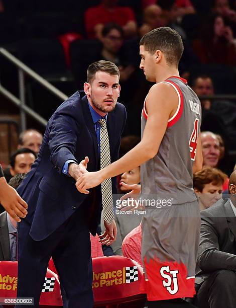 Federico Mussini meets with assistant coach Greg St Jean of the St JohnÕs Red Storm against the Penn State Nittany Lions at Madison Square Garden on...