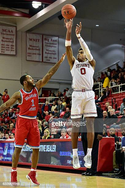 Federico Mussini of the St John's Red Storm attempts a shot against DeAndre Haywood of the Delaware State Hornets during the first half at Carnesecca...
