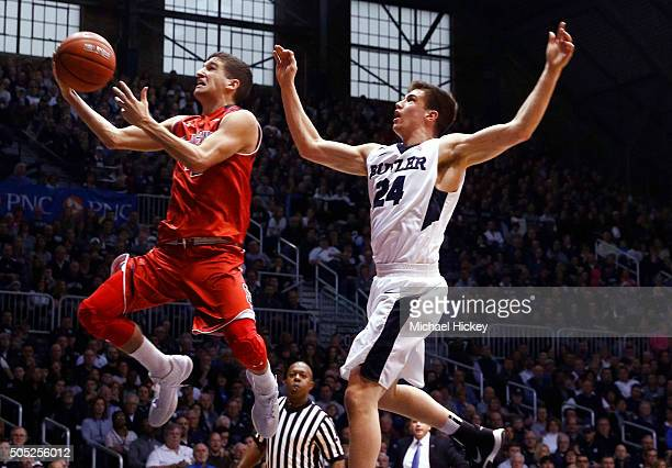 Federico Mussini of the St John's Red Storm shoots the ball as Kellen Dunham of the Butler Bulldogs defends from behind at Hinkle Fieldhouse on...