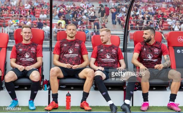 Federico Palacios of 1. FC Nuernberg, Hanno Behrens of 1. FC Nuernberg, Sebastian Kerk of 1. FC Nuernberg and Mikael Ishak of 1. FC Nuernberg sit on...