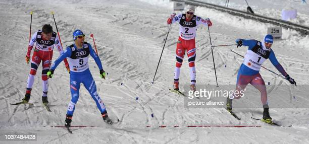 Federico Pellegrino celebrates while crossing the finishing line at the 2017 Nordic World Ski Championships in Lahti Finland 23 February 2017 Around...