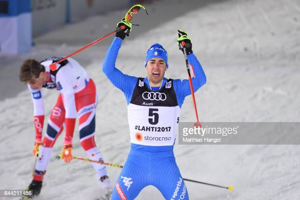 Federico Pellegrino of Italy celebrates after winning the gold medal in the Men's 16KM Cross Country Sprint final during the FIS Nordic World Ski...