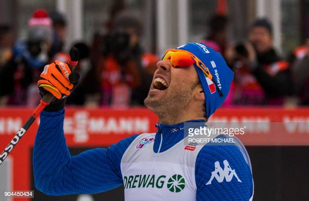 Federico Pellegrino of Italy celebrates after winning the men's 12 km sprint final race of the FIS World cup in Dresden eastern Germany on January 13...