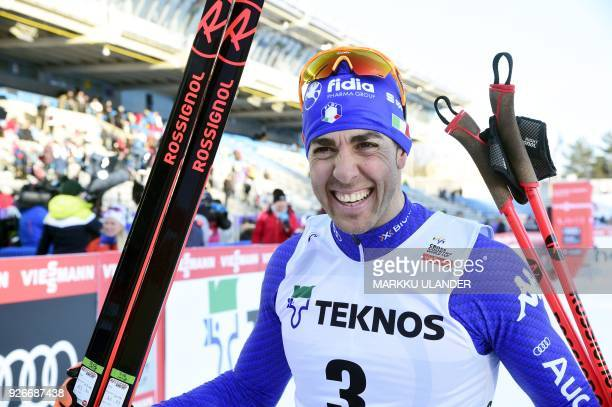 Federico Pellegrino of Italy celebrates after winning the Men's CrossCountry Sprint free final of the FIS World Cup in Lahti Finland on March 3 2018...