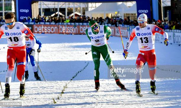 Federico Pellegrino of Italy sprints to take the 4th place behind second placed Norway's Emil Iversen and third placed Norway's Sindre Boernestad...