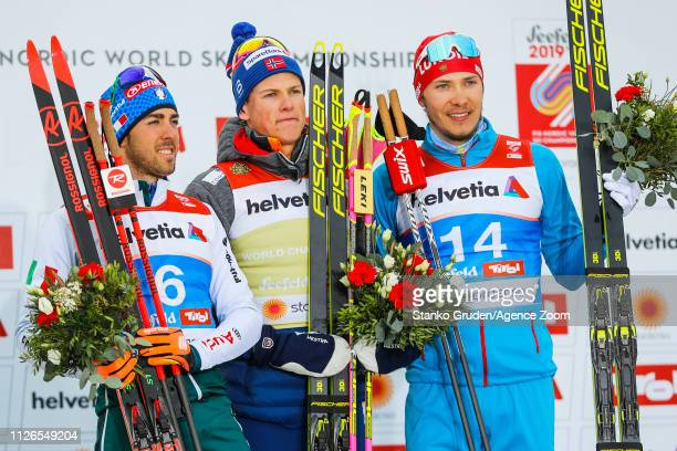 Federico Pellegrino of Italy takes 2nd place Johannes Hoesflot Klaebo of Norway takes 1st place Gleb Retivykh of Russia takes 3rd place during the...
