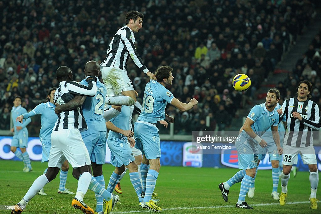 Federico Peluso (Up) of Juventus FC scores the opening goal during the TIM cup match between Juventus FC and S.S. Lazio at Juventus Arena on January 22, 2013 in Turin, Italy.