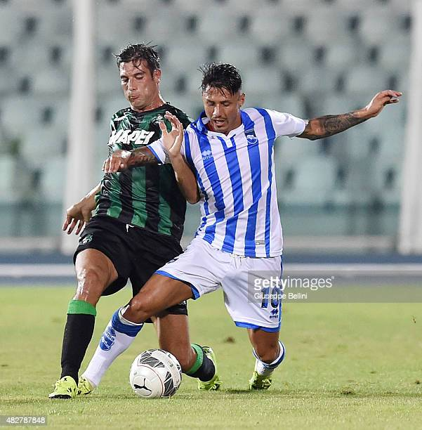 Federico Peluso of Sassuolo and Gianluca Lapadula of Pescara in action during the preseason friendly match between Pescara Calcio and US Sassuolo...