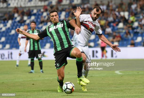 Federico Peluso of US Sassuolo competes for the ball whit Goran Pandev of Genoa CFC during the Serie A match between US Sassuolo and Genoa CFC at...