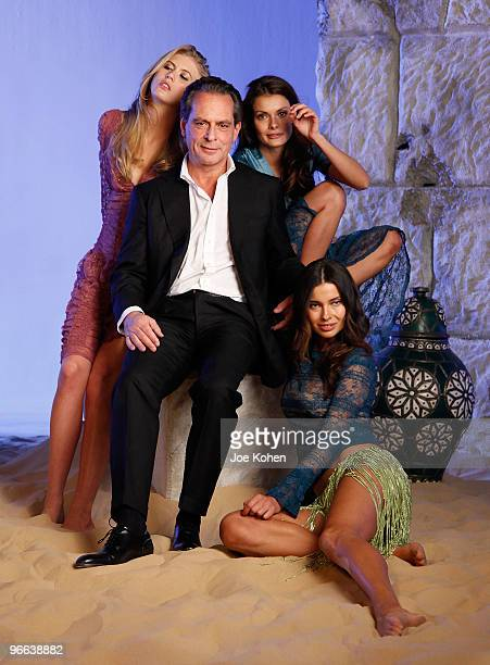 Federico Pignatelli Founder of Art Fashion Group poses with models on a photo set at the Pier 59 Studios 15th anniversary party at Pier 59 Studios on...
