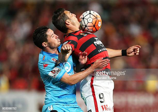 Federico Piovaccari of the Wanderers competes with Dylan McGowan of Adelaide during the round 13 ALeague match between the Western Sydney Wanderers...