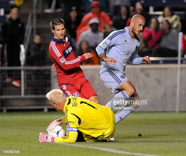 Federico Puppo of the Chicago Fire tries to score on goalkeeper Jimmy Nielsen of the Sporting Kansas City as Aurelien Collin defends during the...