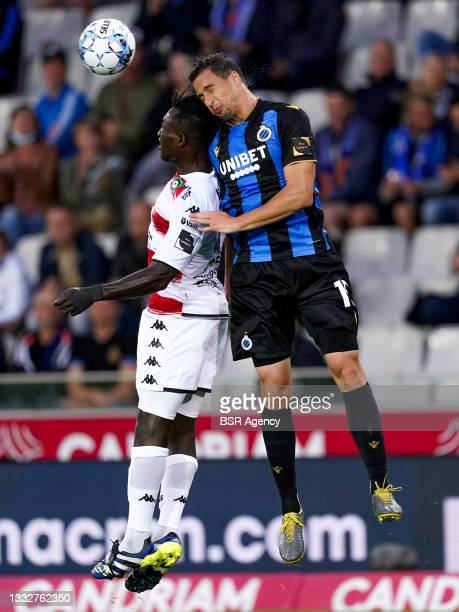 Federico Ricca of Club Brugge fights for a headed ball with Kevin Denkey of Cercle Brugge during the Jupiler Pro League match between Club Brugge and...