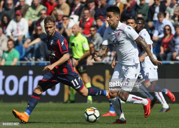 Federico Ricci of Crotone competes for the ball with Erick Pulgar of Bologna during the serie A match between FC Crotone and Bologna FC at Stadio...