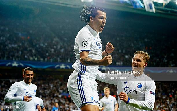 Federico Santander and Ludvig Augustinsson of FC Copenhagen celebrate after scoring their third goal during the UEFA Champions League match between...