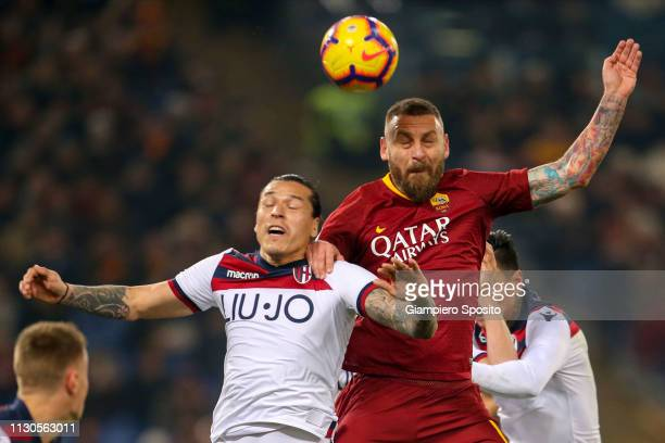 Federico Santander of Bologna and Daniele De Rossi of AS Roma jump for the ball during the Serie A match between AS Roma and Bologna FC at Stadio...