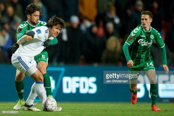 Federico Santander of FC Copenhagen and Joao Pereira of OB Odense compete for the ball during the Danish Alka Superliga match between FC Copenhagen...
