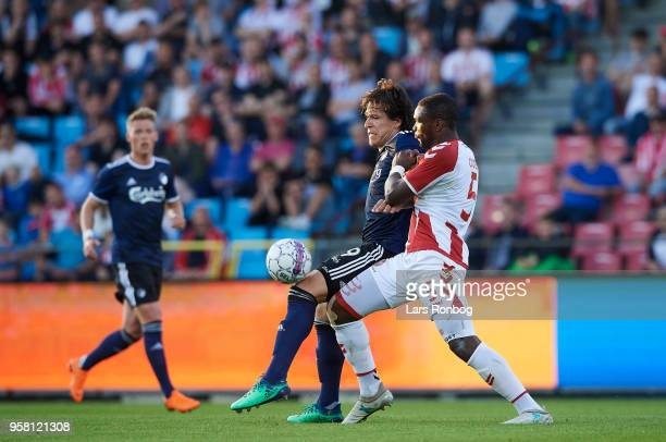 Federico Santander of FC Copenhagen and Jores Okore of AaB Aalborg compete for the ball during the Danish Alka Superliga match between AaB Aalborg...