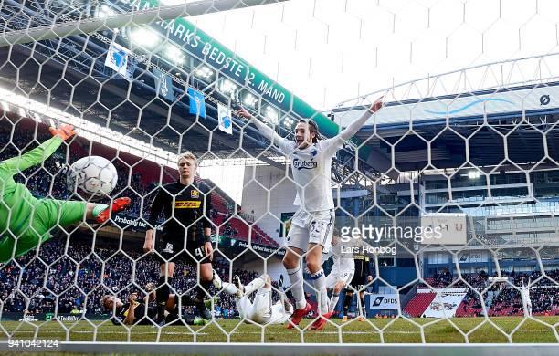 Federico Santander of FC Copenhagen scores the 21 goal against Goalkeeper Runar Alex Runarsson of FC Nordsjælland and Rasmus Falk of FC Copenhagen...