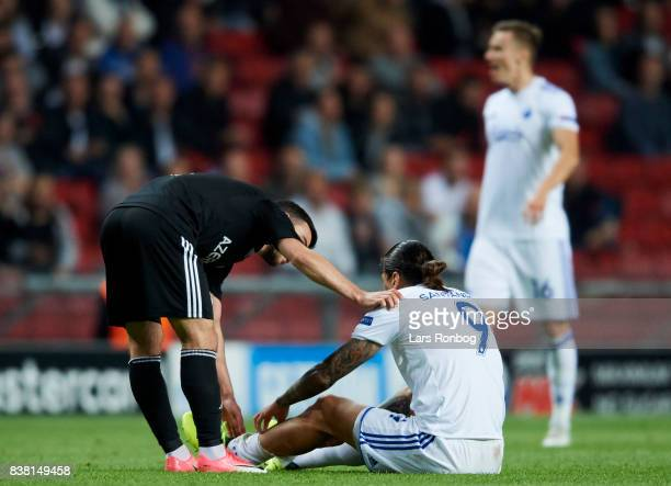 Federico Santander of FC Copenhagen sitting injured on te pitch during the UEFA Champions League Playoff 2nd Leg match between FC Copenhagen and...