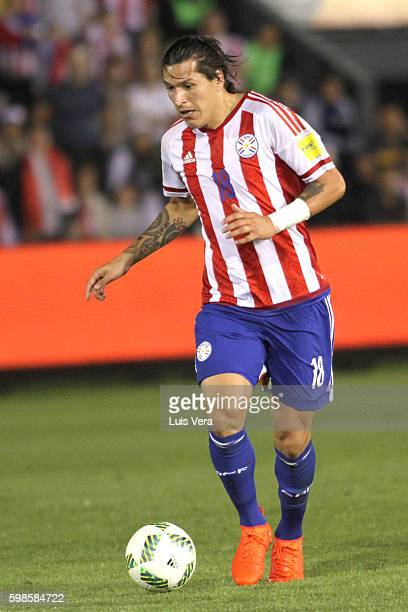 Federico Santander of Paraguay drives the ball during a match between Paraguay and Chile as part of FIFA 2018 World Cup Qualifiers at Defensores del...