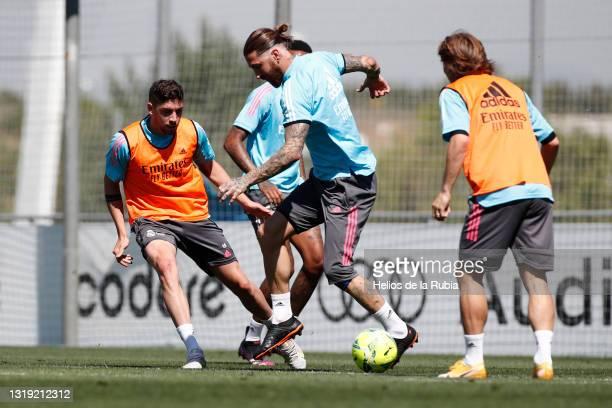 Federico Valverde and Sergio Ramos both of Real Madrid are training with teammates Éder Militão and Luka Modric at Valdebebas training ground on May...