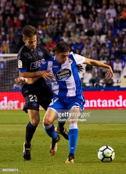 Federico Valverde of Deportivo de La Coruna is challenged by Alvaro Medran of Deportivo Alaves during the La Liga match between Deportivo La Coruna...
