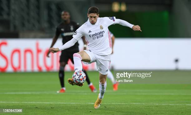 Federico Valverde of Madrid runs with the ball during the UEFA Champions League Group B stage match between Borussia Moenchengladbach and Real Madrid...