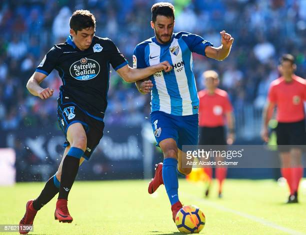 Federico Valverde of RC Deportivo competes for the ball with Juan Carlos Perez of Malaga CF during the La Liga match between Malaga and Deportivo La...