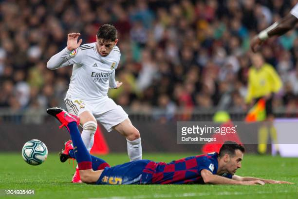Federico Valverde of Real Madrid and Sergio Busquets of FC Barcelona battle for the ball during the Liga match between Real Madrid CF and FC...