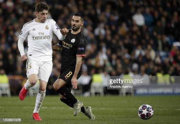 Federico Valverde of Real Madrid argues with Ilkay Gundogan of Manchester City during the UEFA Champions League round of 16 first leg soccer match...