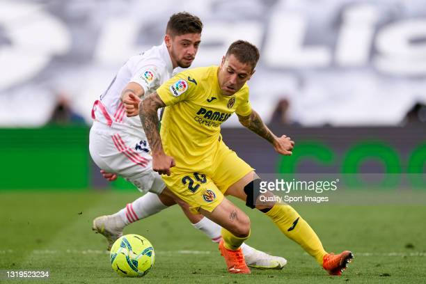 Federico Valverde of Real Madrid battle for the ball with Ruben Pena of Villarreal CF during the La Liga Santander match between Real Madrid and...