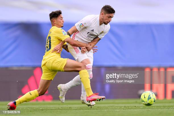 Federico Valverde of Real Madrid battle for the ball with Yeremy of Villarreal CF during the La Liga Santander match between Real Madrid and...